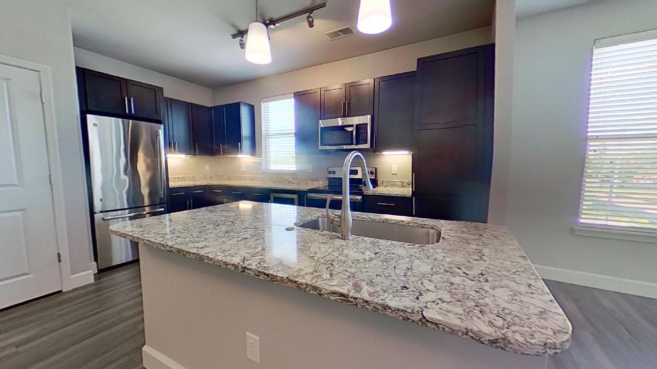 Kitchen Island at the Vue at Creve Coeur Apartments in Creve Coeur, MO