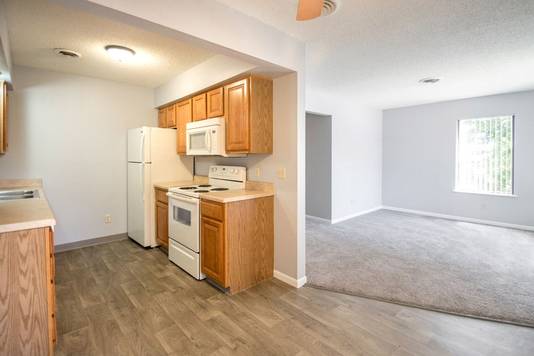 Renovated Kitchen & Living Room at Crystal Ridge Apartments in Davenport, IA