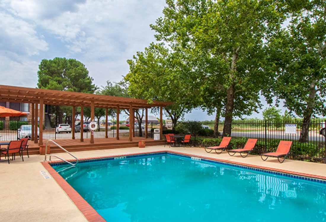 Sparking Swimming Pool with Patio at Curry Junction Apartments in Abilene, Texas