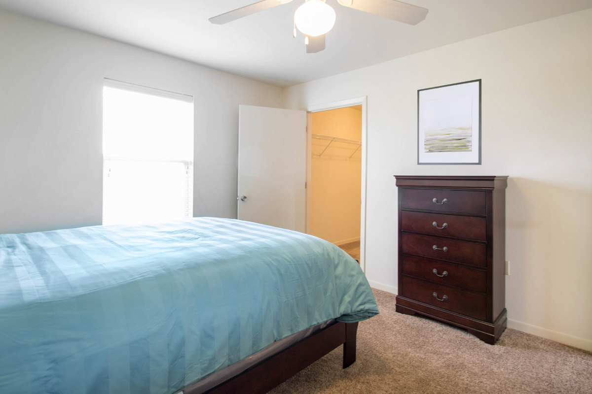 Spacious Bedroom with Walk-In Closet at Cypress Bend Apartments in Beaumont, TX