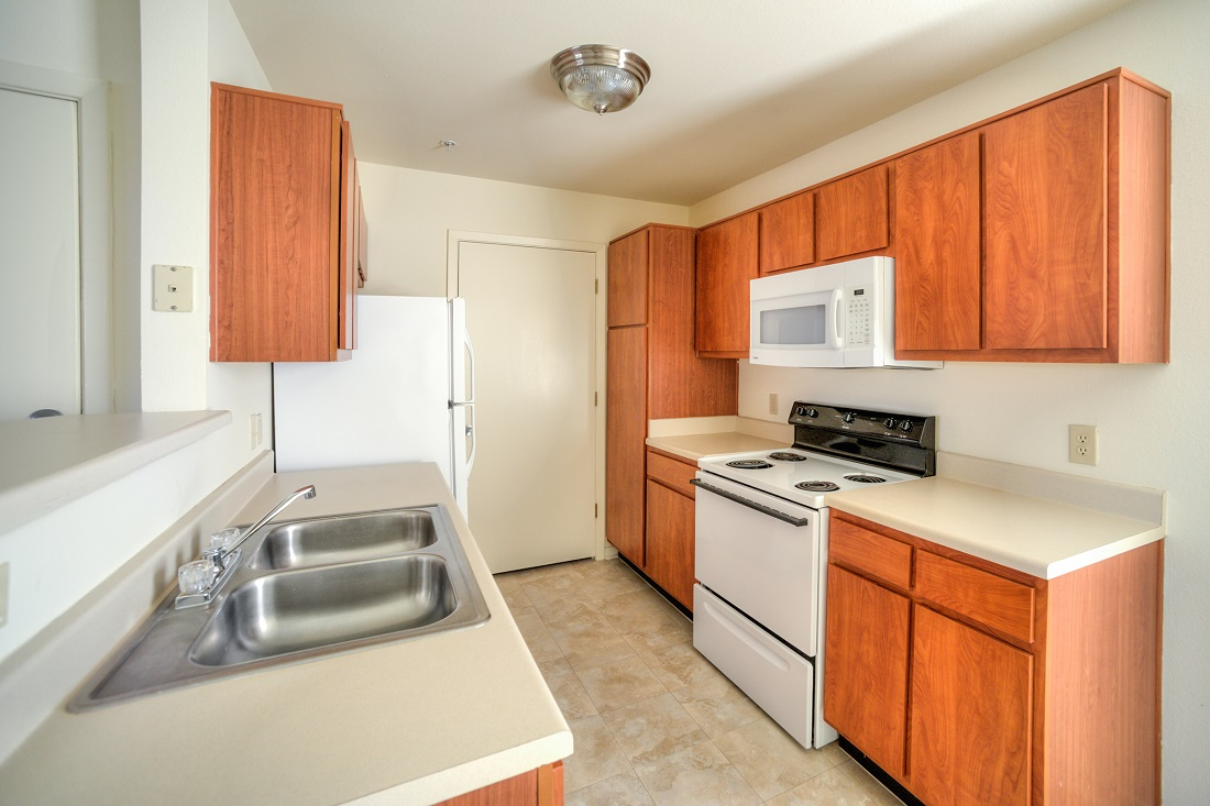 Large Kitchen with Cabinet Storage at Cypress Bend Apartments in Beaumont, TX