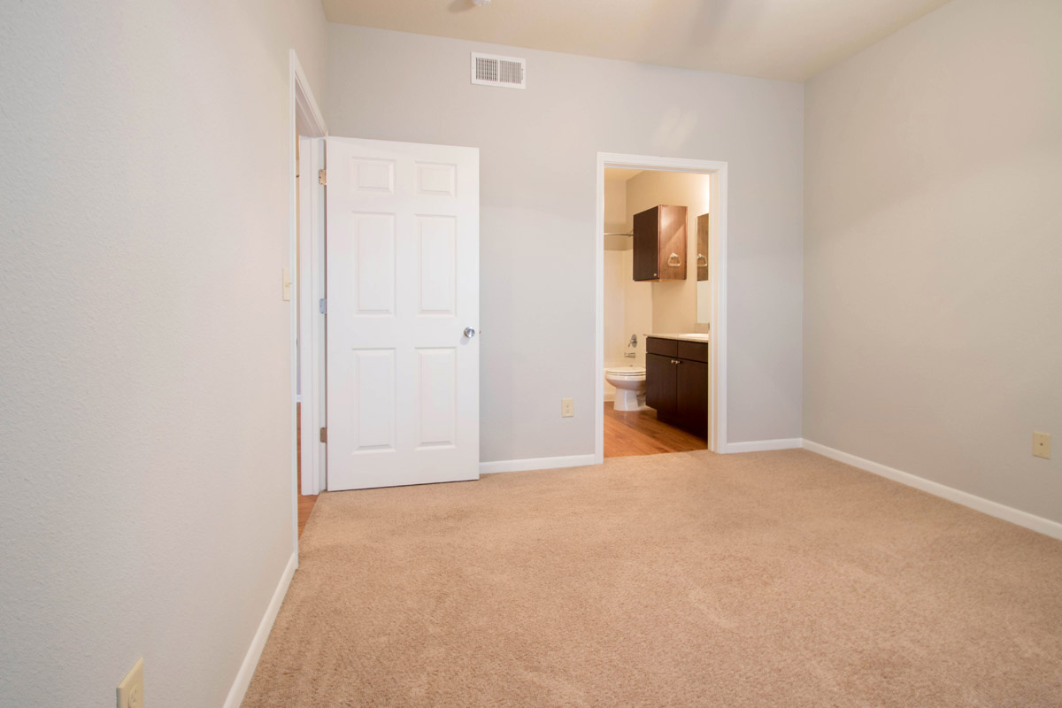 Spacious Bedrooms at Cypress Bend Village Apartments in Beaumont, TX