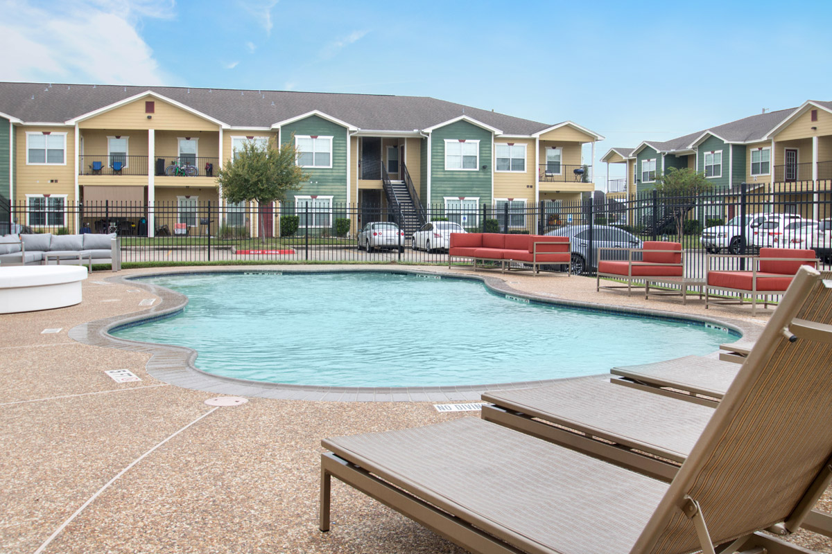 Swimming Pool with Beautiful Patio at Cypress Bend Village Apartments in Beaumont, TX