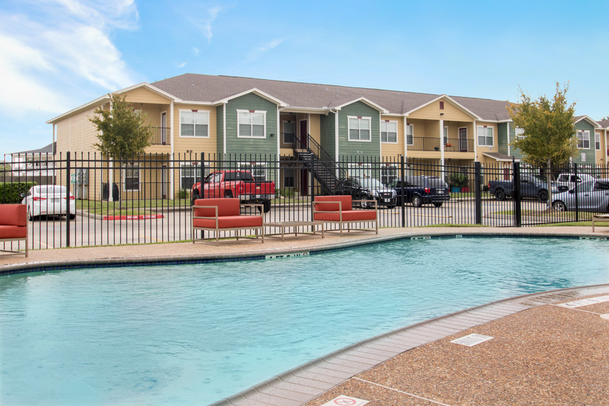 Outdoor Swimming Pool at Cypress Bend Village Apartments in Beaumont, TX