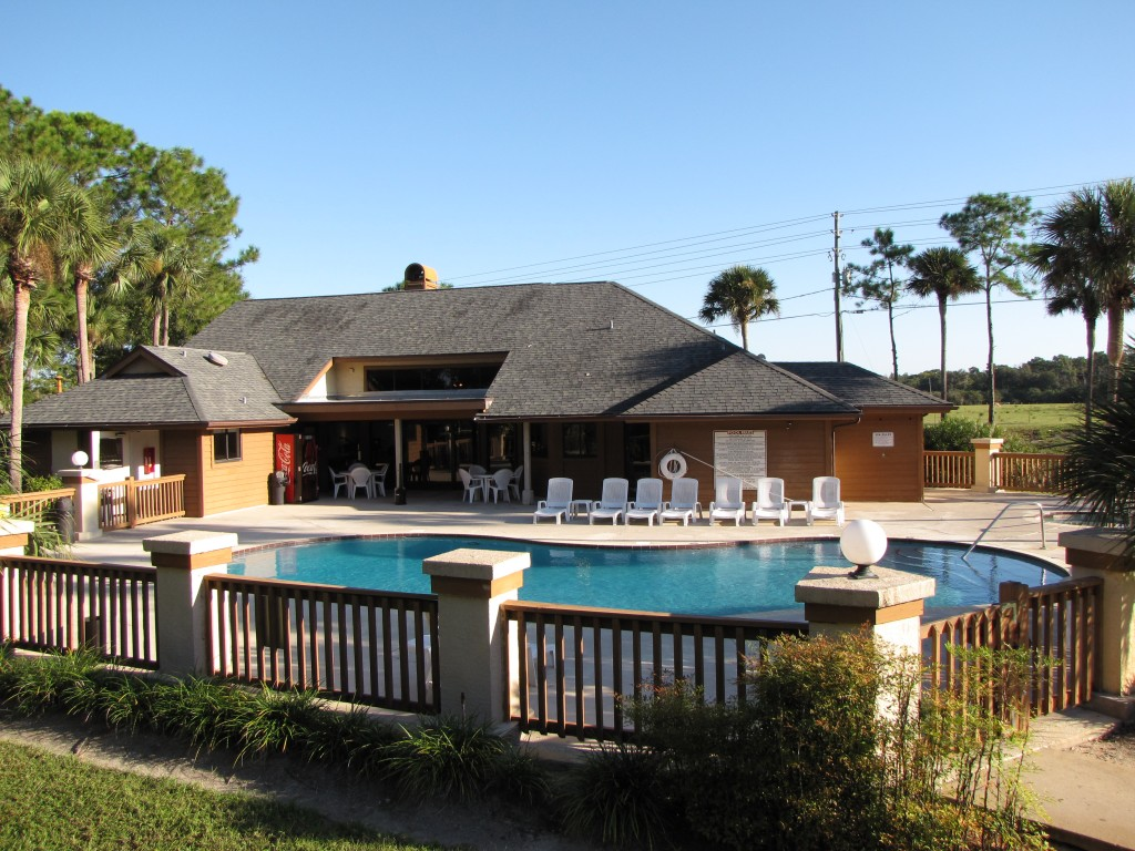 Pool Lounge Area at Cypress Trail Apartments in New Port Richey, FL