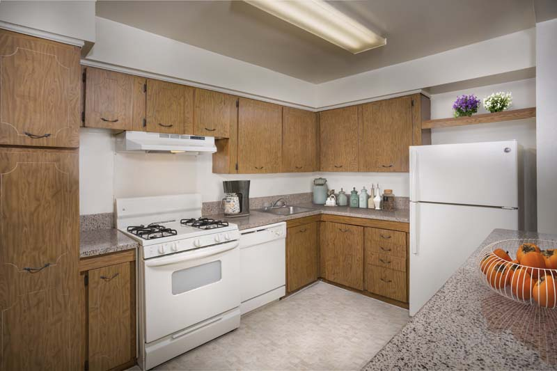 Fully-equipped kitchen at Deerfield Run & Village Square North Apartments in Laurel, MD