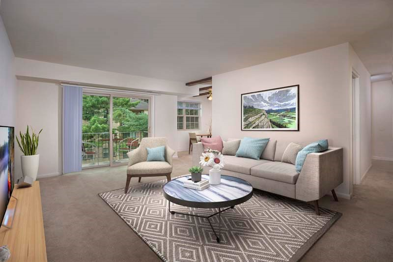 Spacious living area with large balcony at Deerfield Run & Village Square North Apartments