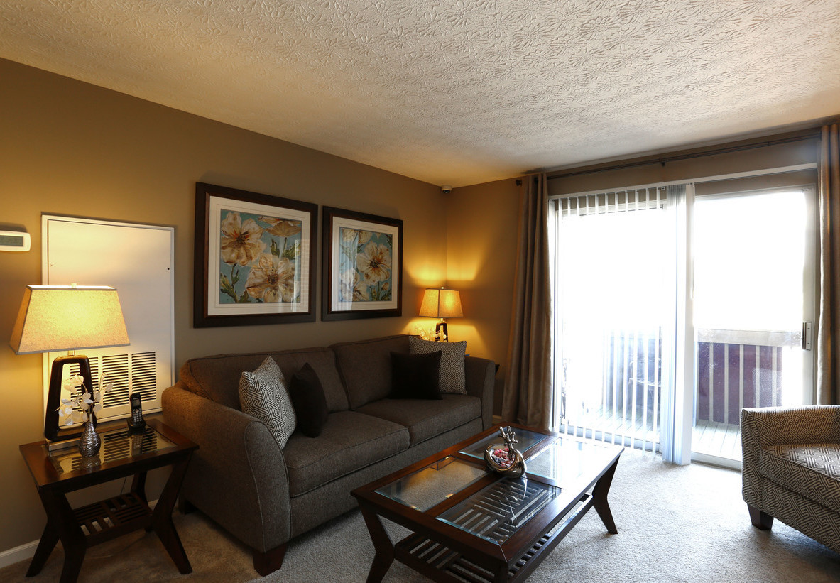 Living Room Area with Natural Light at Deer Park Apartments in Loveland, Ohio