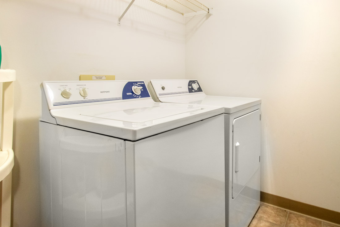 Laundry Room at Delaware Crossing Apartments in Ankeny, Iowa