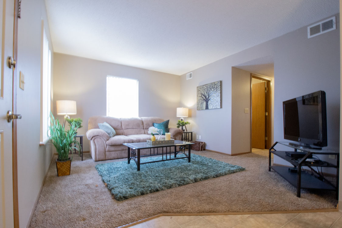Spacious Living Room at Delaware Crossing Apartments in Ankeny, Iowa
