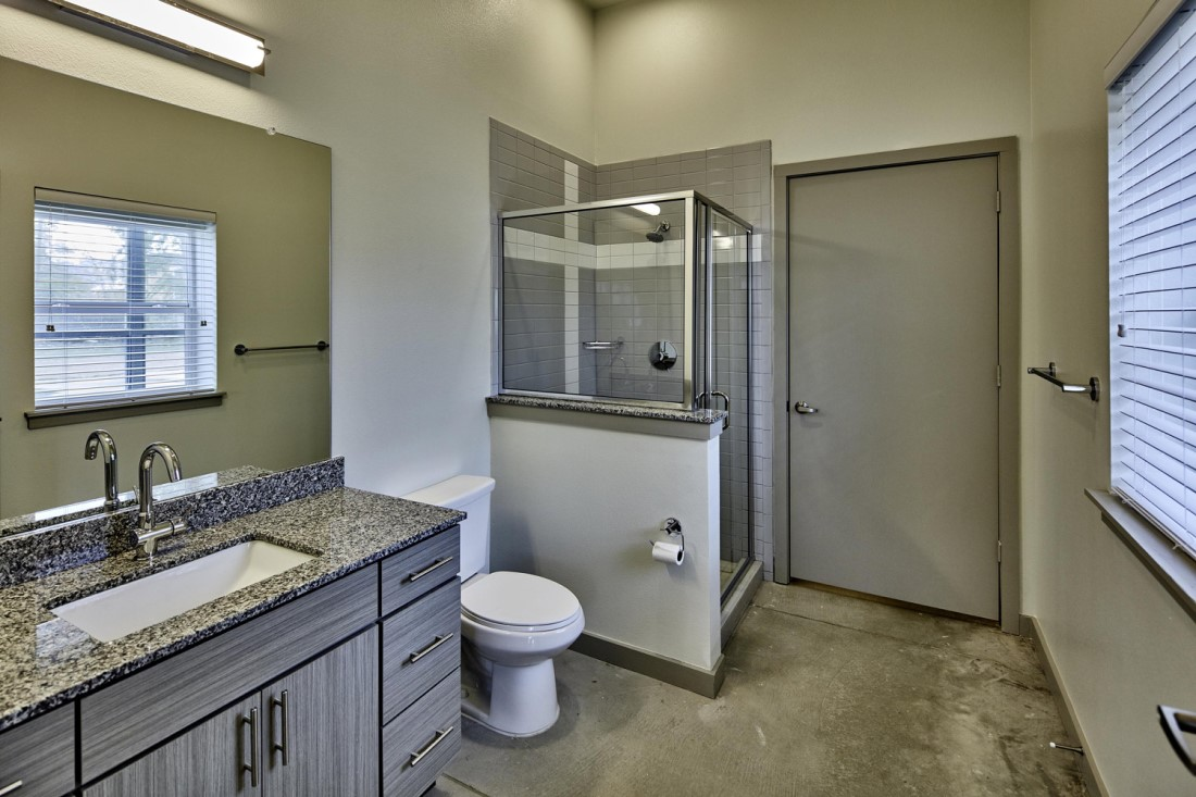 Stand-In Apartment Bathroom Shower At Digit 1919 Apartments In Dallas, TX
