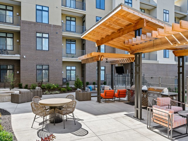 Covered Poolside Seating at The District Flats Apartments in Lenexa, KS