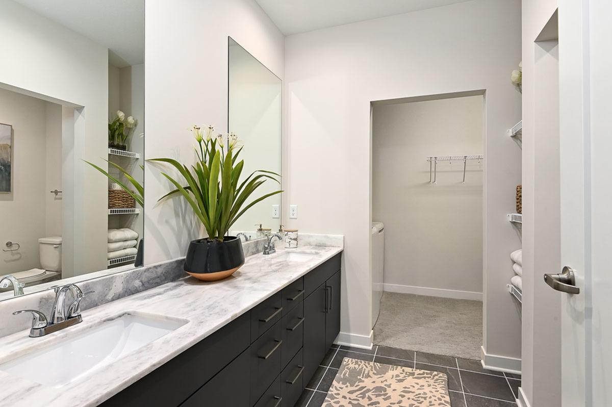 Double Vanity Bathroom at The District Flats Apartments in Lenexa, KS