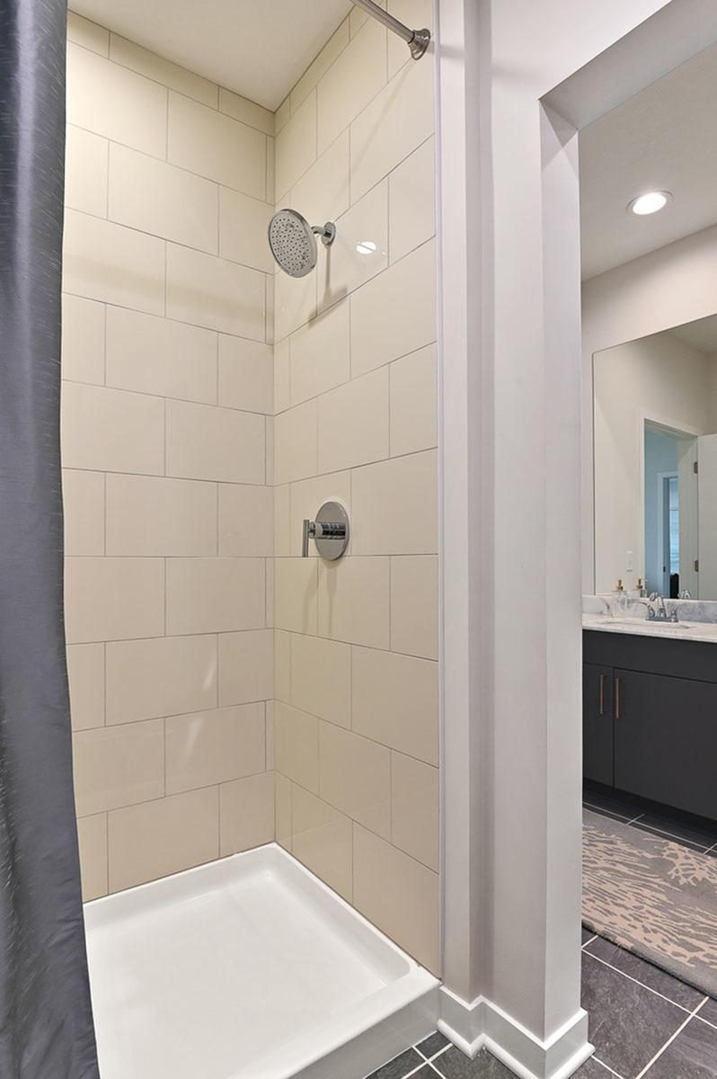 Standing Shower at The District Flats Apartments in Lenexa, KS