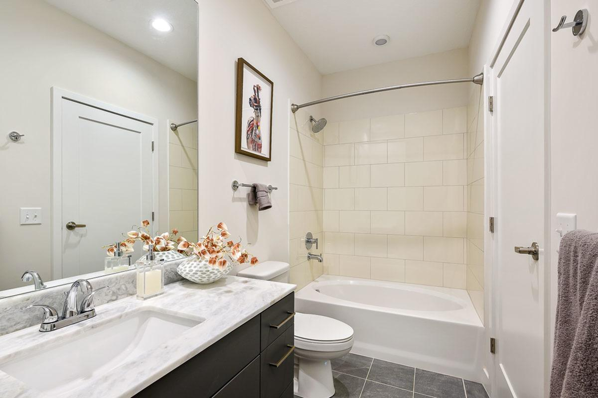 Shower and Tub Combination at The District Flats Apartments in Lenexa, KS
