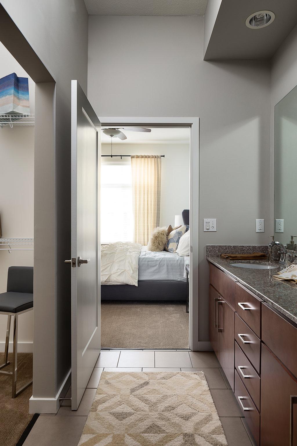 Bathroom with Granite Double Vanity at Domain City Center Luxury Apartments in Lenexa, Kansas