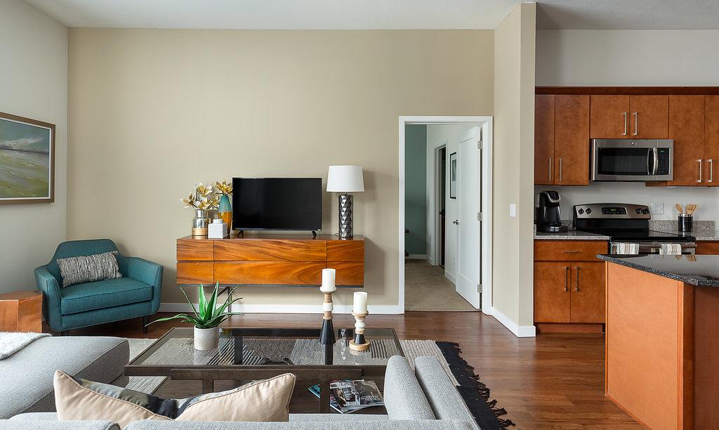 Open Living Area with Hardwood Floors at Domain City Center Luxury Apartments in Lenexa, Kansas