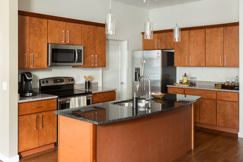 Fully-Equipped Kitchen at Domain City Center Luxury Apartments in Lenexa, Kansas