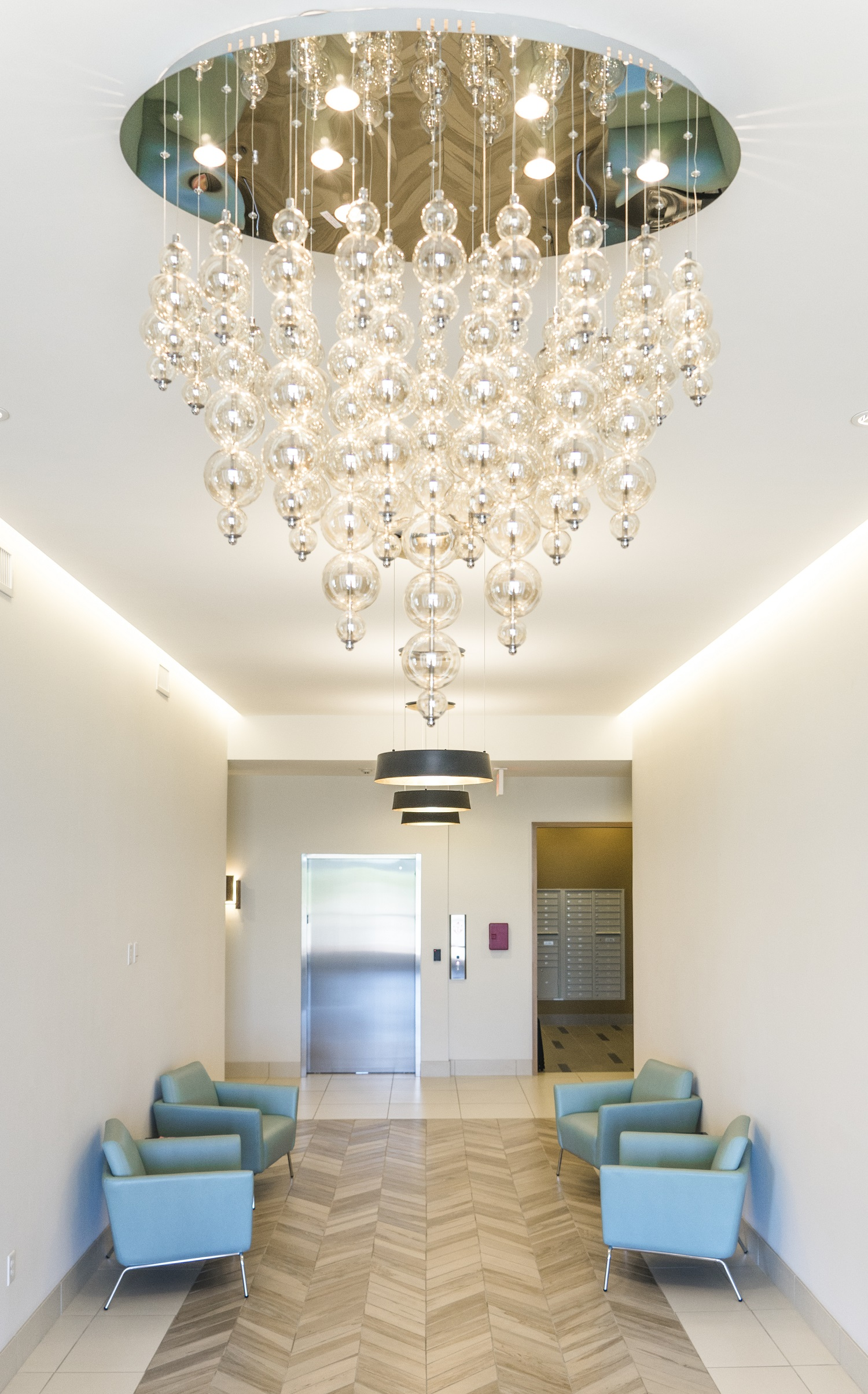 Gorgeous Chandelier and Modern Finishes at Domain City Center Luxury Apartments in Lenexa, Kansas