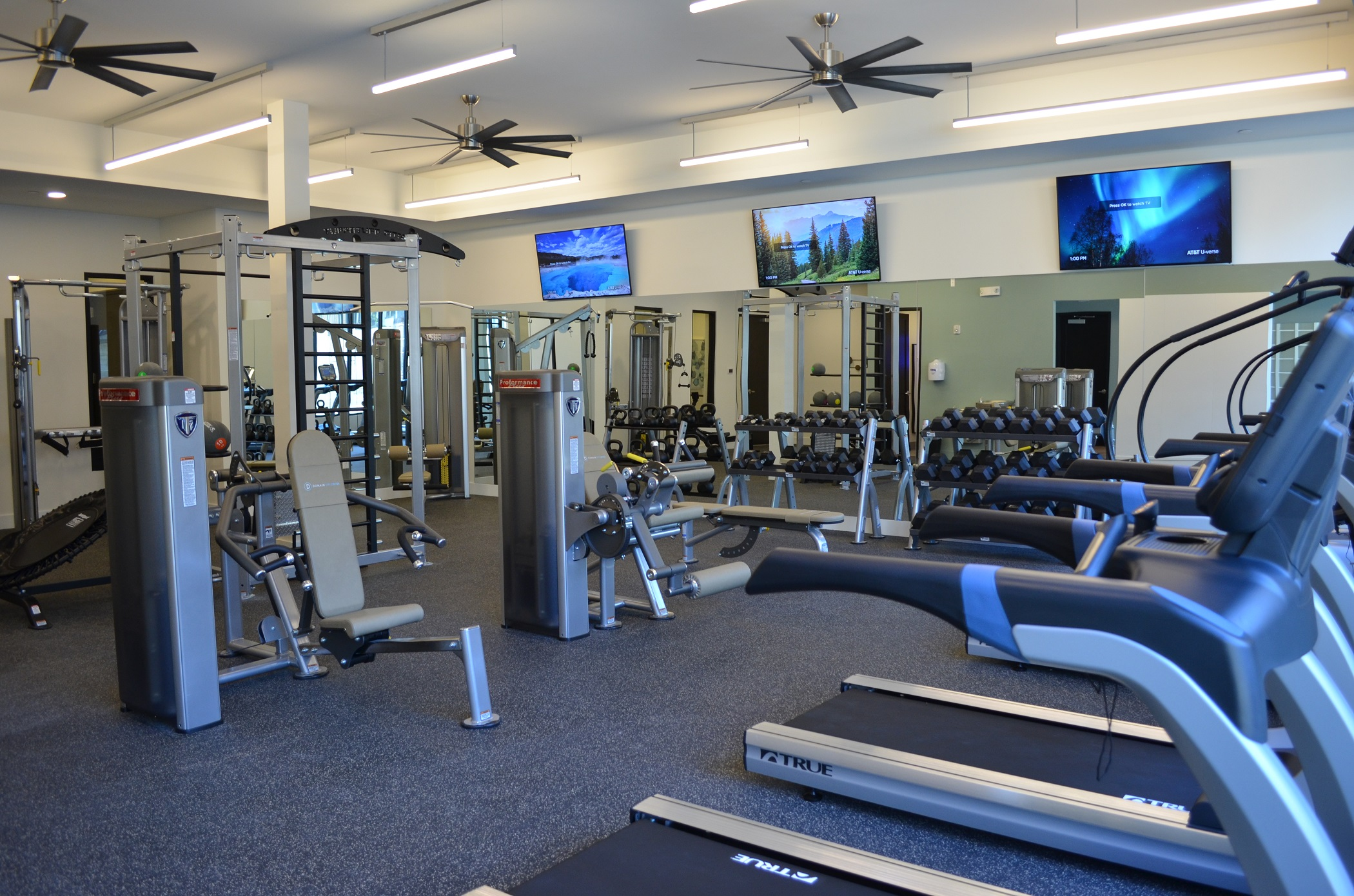 Fully-Equipped Fitness Center at Domain City Center Luxury Apartments in Lenexa, Kansas