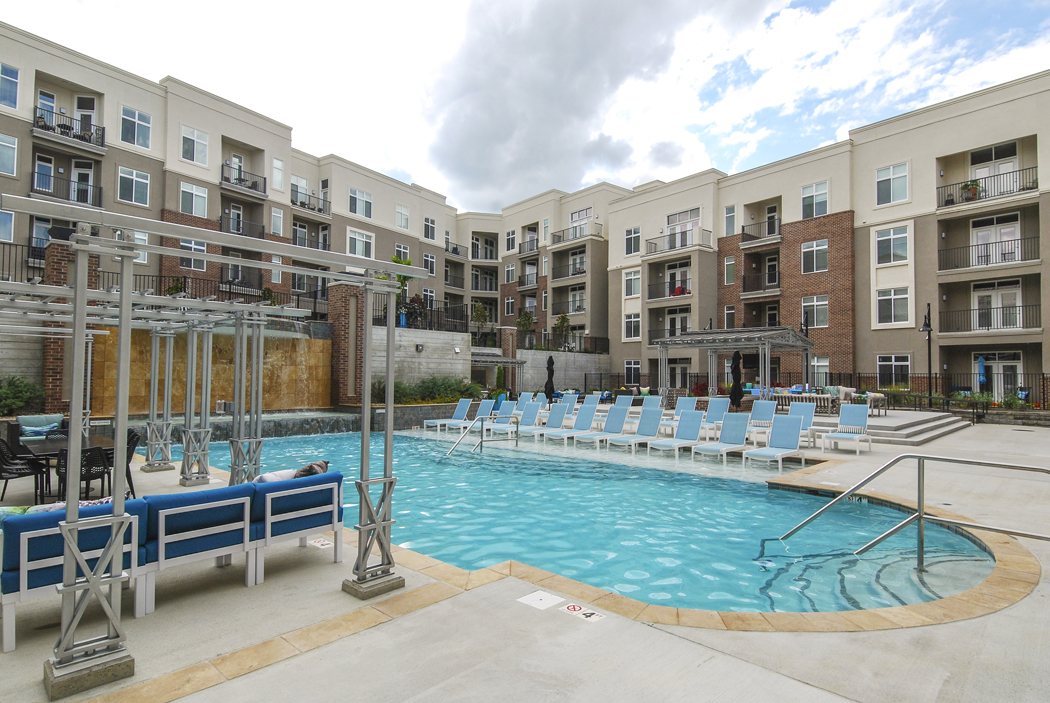 Sparkling Swimming Pool with Seating at Domain City Center Luxury Apartments in Lenexa, Kansas