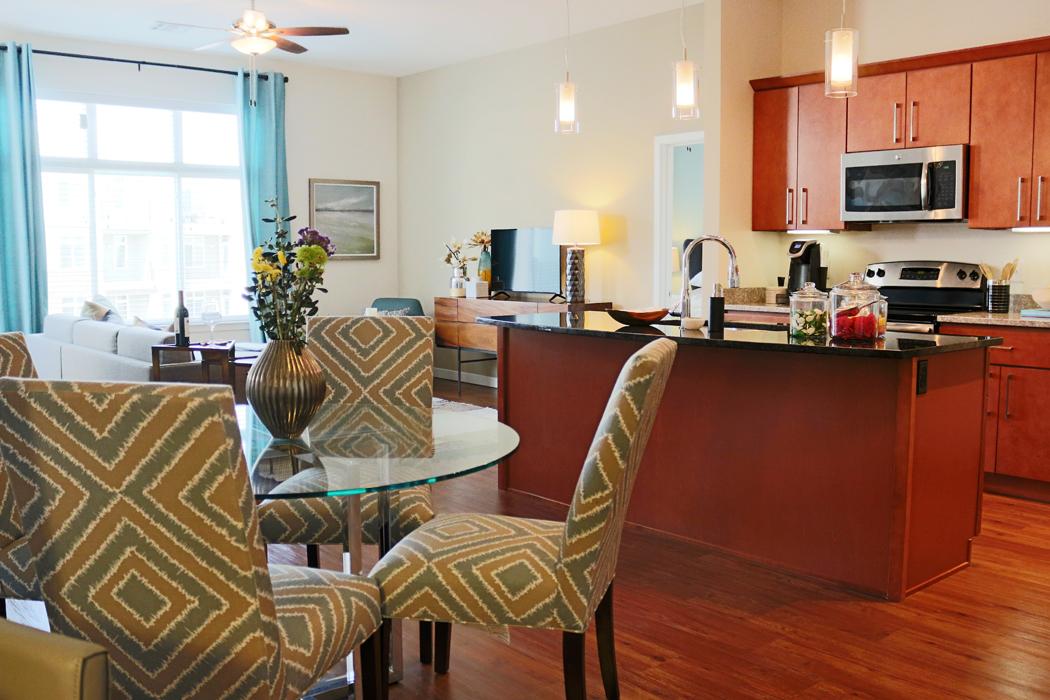 Spacious Kitchen with Dining Area at Domain City Center Apartments in Lenexa, KS