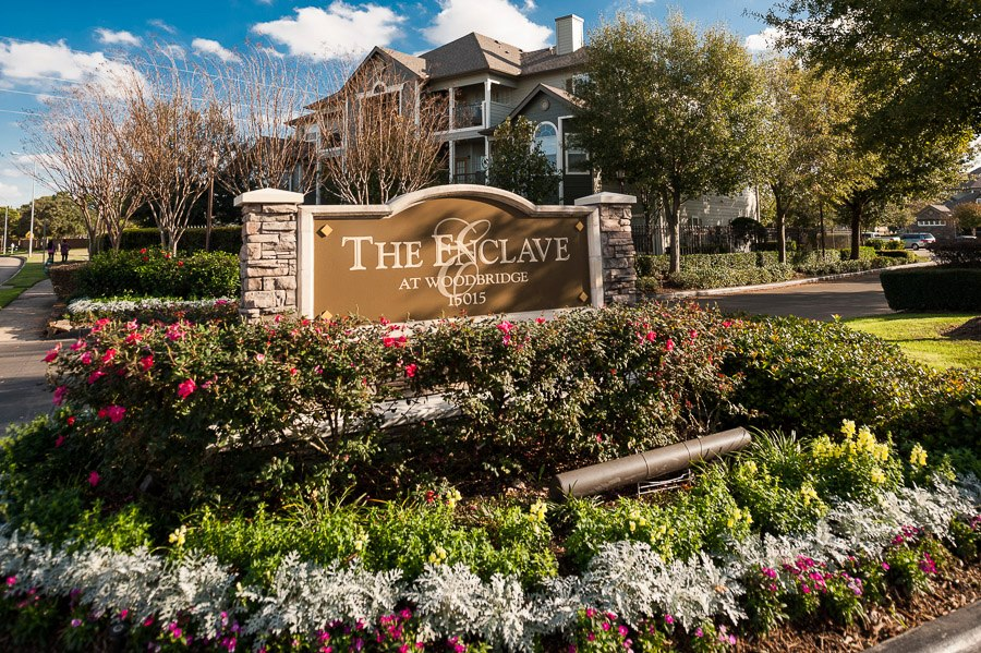 Welcome Sign at The Enclave at Woodbridge Apartments in Sugar Land, TX