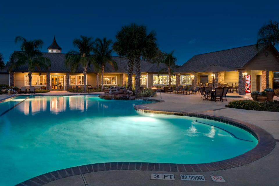 Night Time Pool View at The Enclave at Woodbridge Apartments in Sugar Land, TX