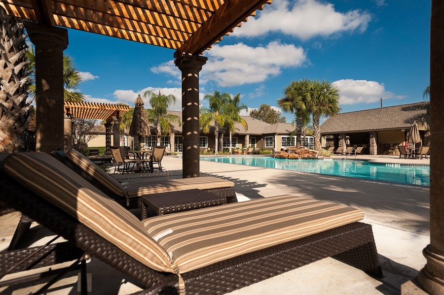 Poolside Seating at The Enclave at Woodbridge Apartments in Sugar Land, TX