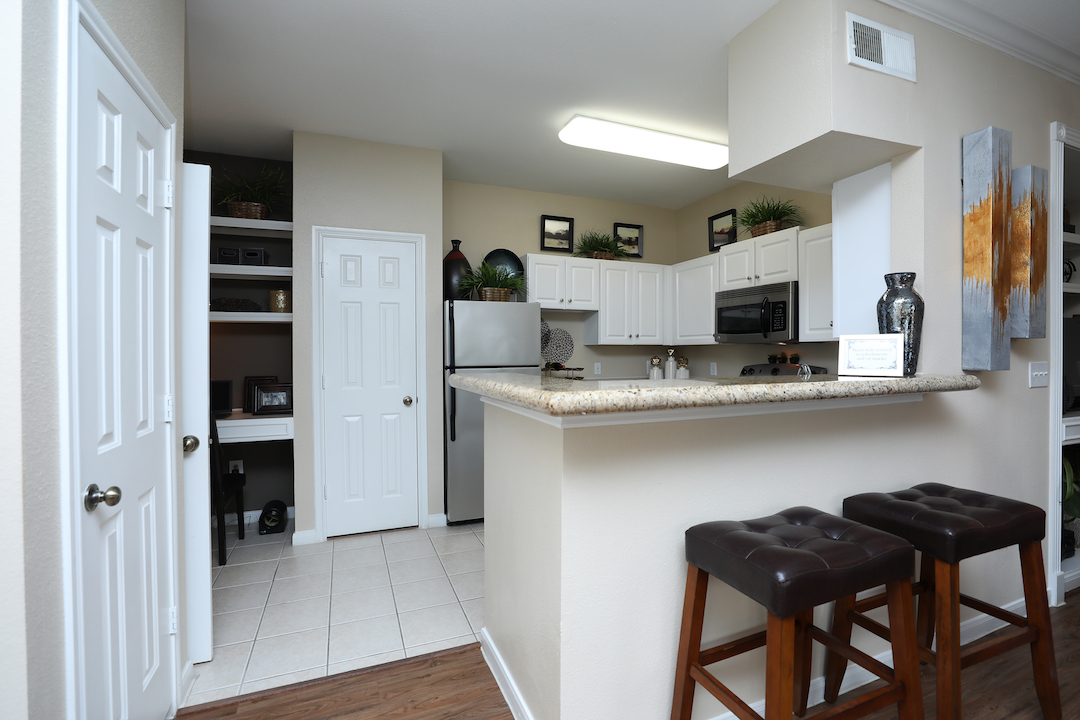 Abundant Counter Space at The Enclave at Woodbridge Apartments in Sugar Land, TX