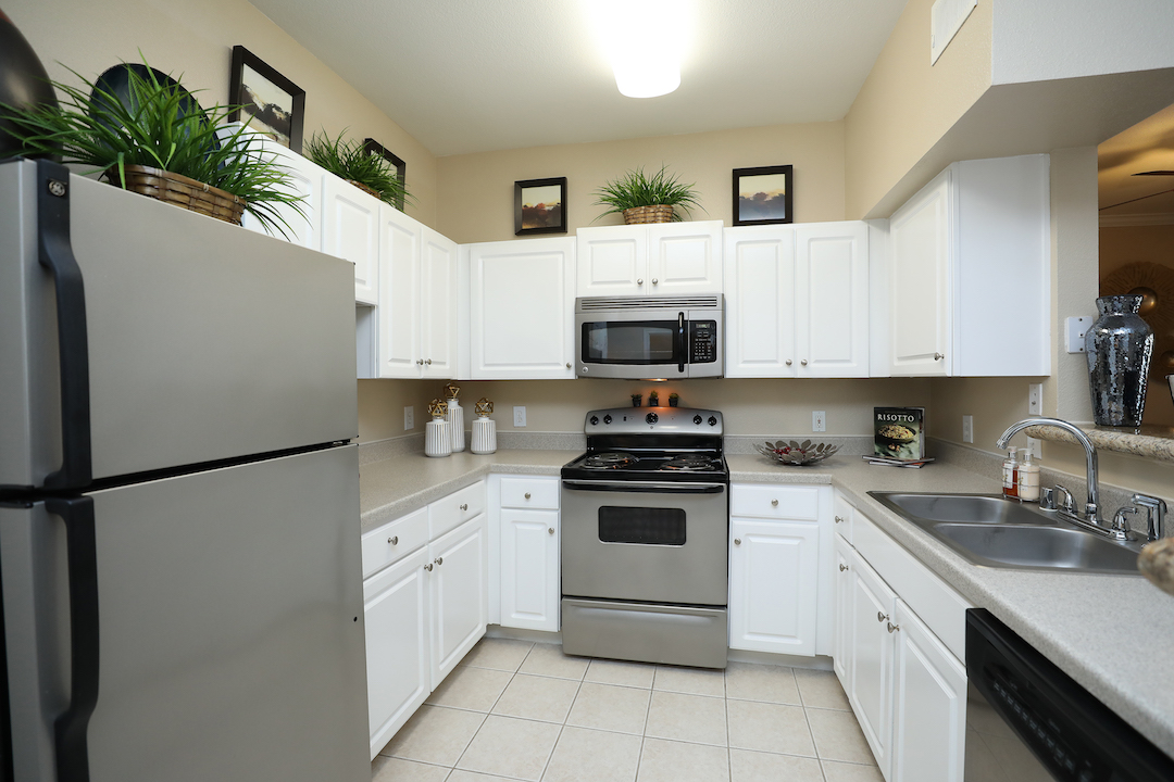 Spacious Kitchen Area at The Enclave at Woodbridge Apartments in Sugar Land, TX