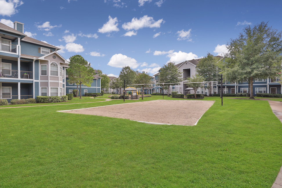 Sand Volleyball Court at The Enclave at Woodbridge Apartments in Sugar Land, TX