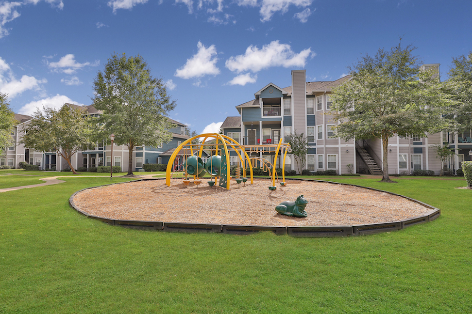 Playground at The Enclave at Woodbridge Apartments in Sugar Land, TX
