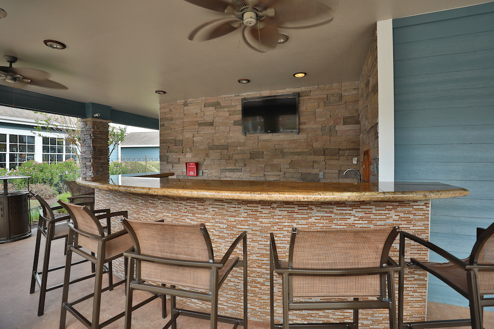 Outdoor Bar at The Enclave at Woodbridge Apartments in Sugar Land, TX