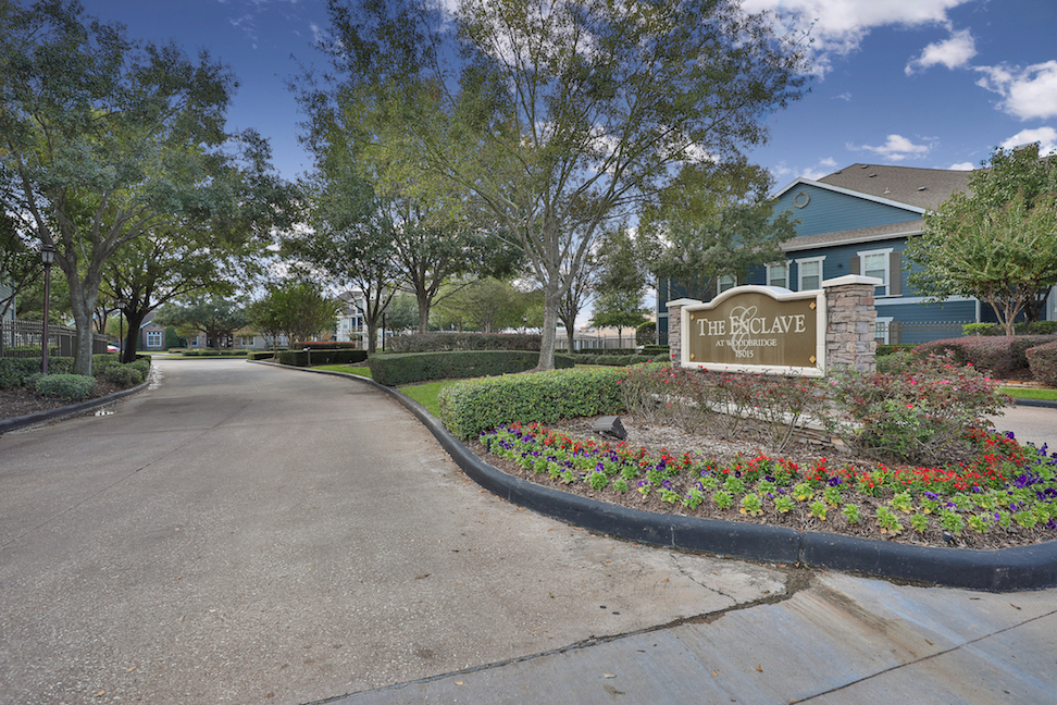 Welcome Signage at The Enclave at Woodbridge Apartments in Sugar Land, TX