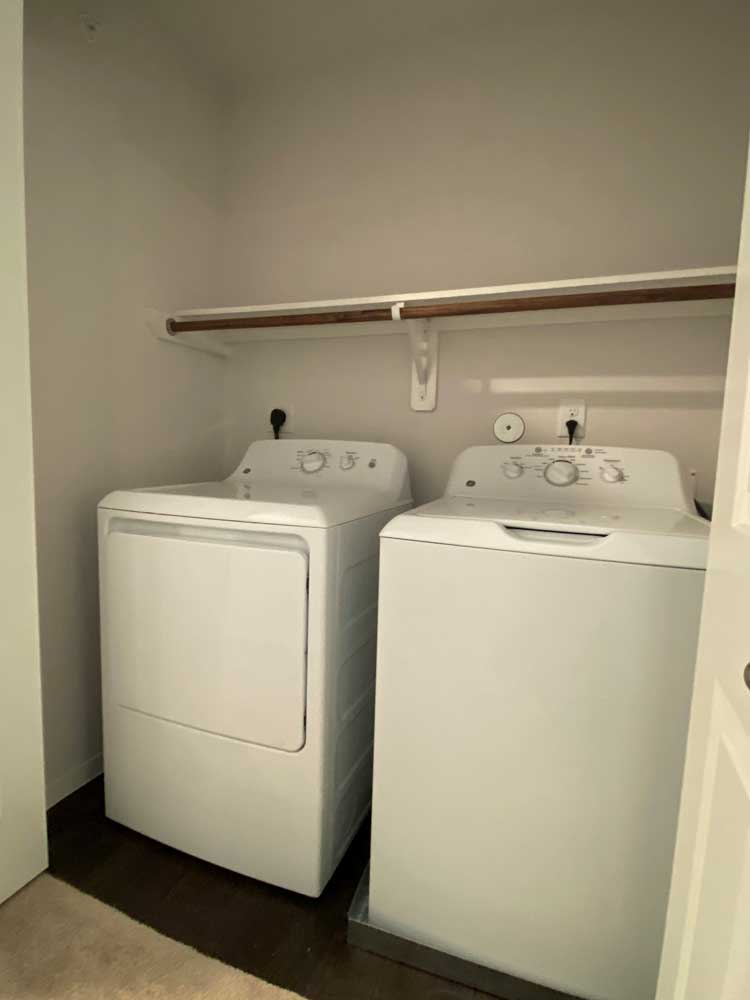 Washer and Dryer at Esperanza at Queenston Apartments in Houston, Texas