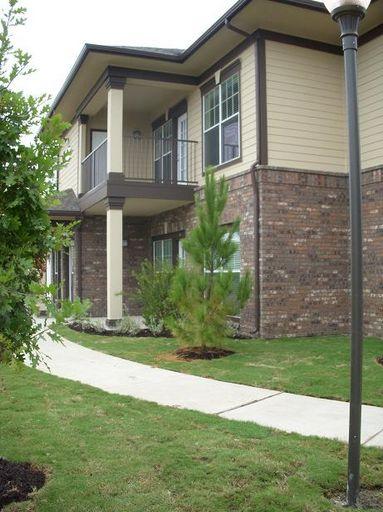 Exterior of Apartment Building at Estate Villas at Krum Apartments in Krum, TX
