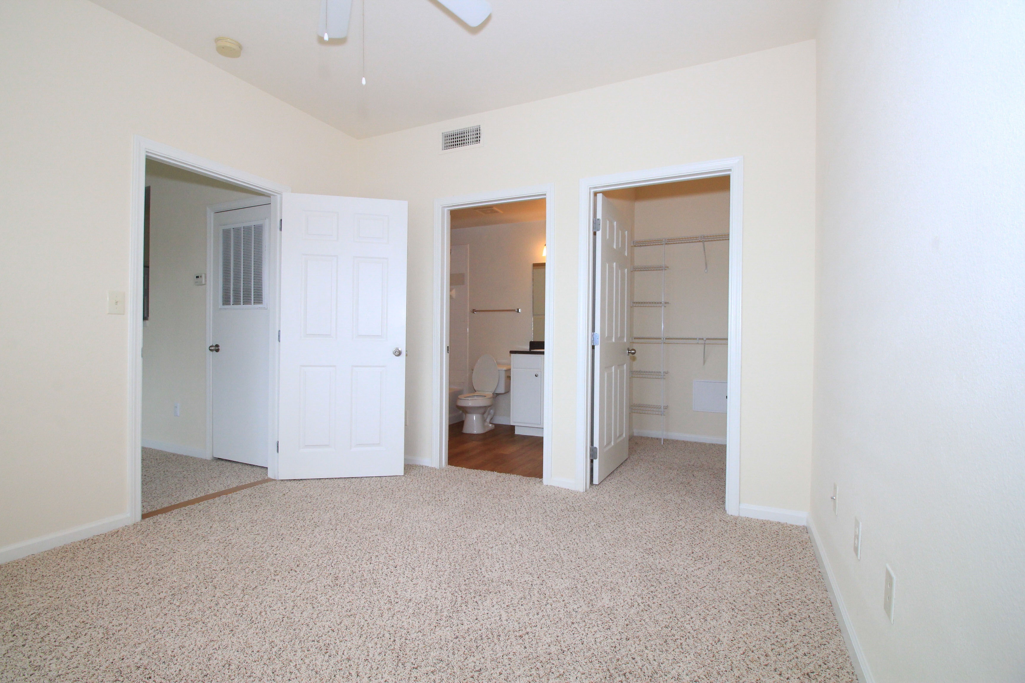 Walk In Closet and Bathroom at The Oxford at Estonia Apartments in San Antonio, TX