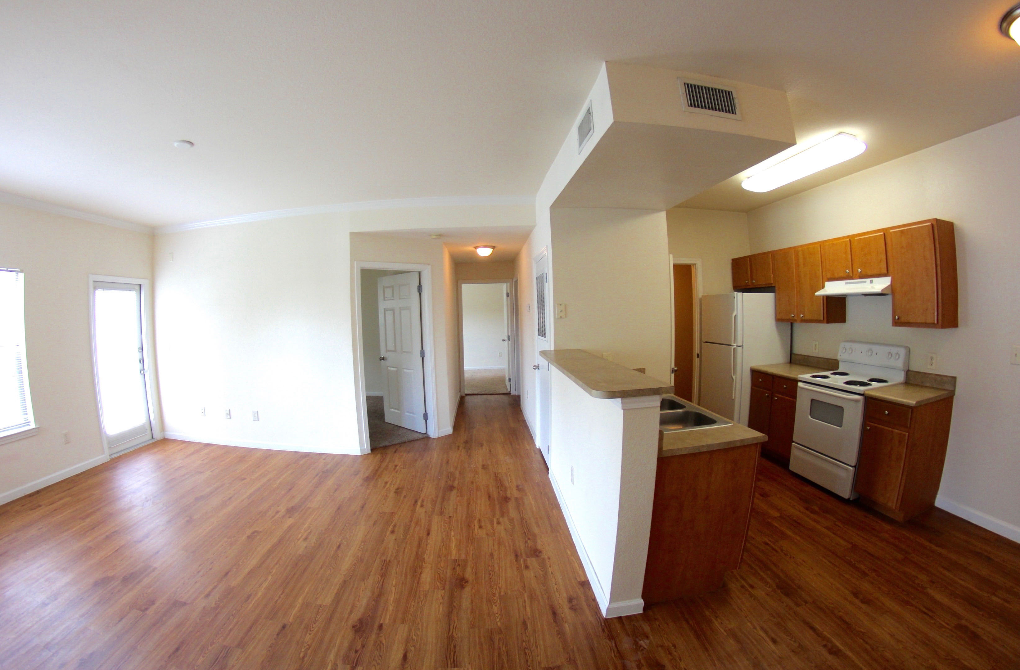 Kitchen, Dining and Living Area at The Oxford at Estonia Apartments in San Antonio, TX