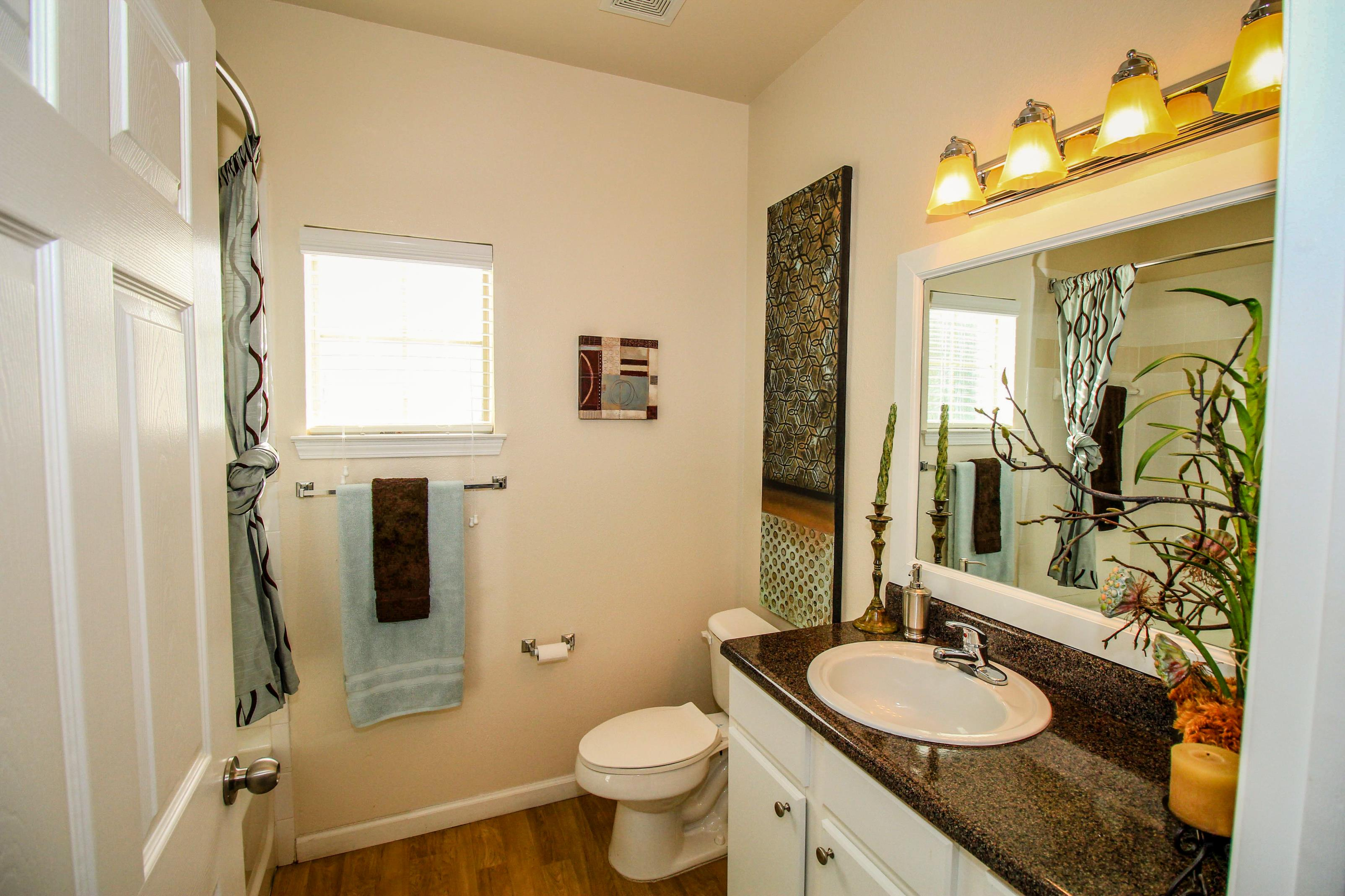 Sophisticated Bathrooms at Oxford at Estonia Apartments in San Antonio, TX