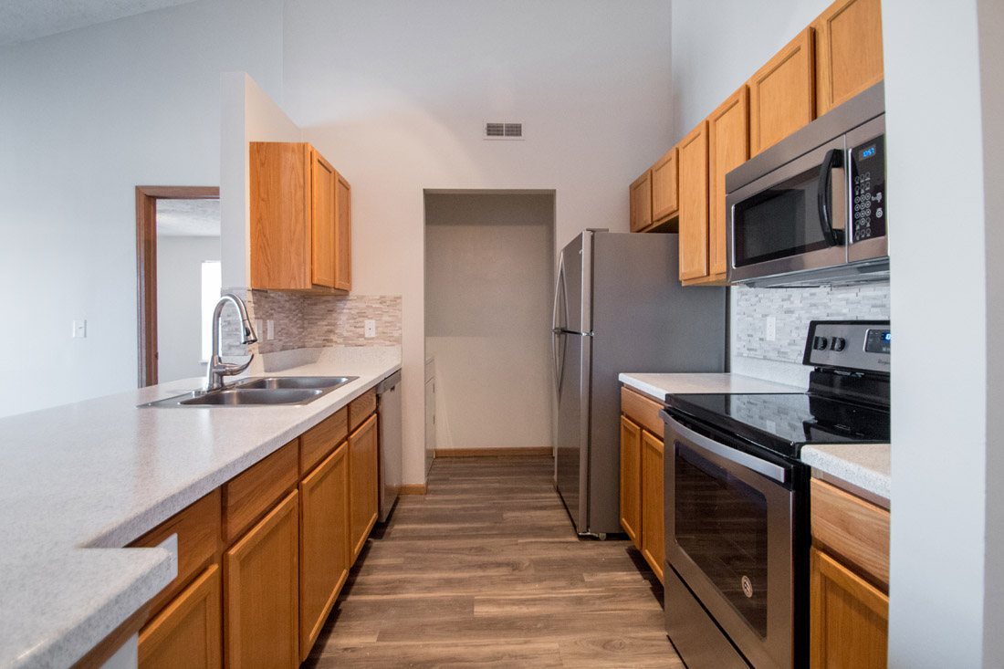 Upgraded Kitchen with Stainless Steel Appliances at Fairfax Apartments in Omaha, Nebraska