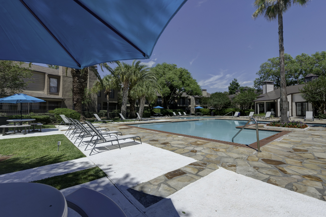 Pool Area at Falls at Clear Lake Apartments in Webster, TX