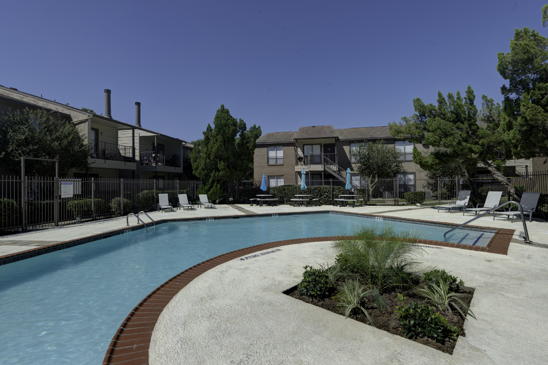 Sparkling Pool at Falls at Clear Lake Apartments in Webster, TX