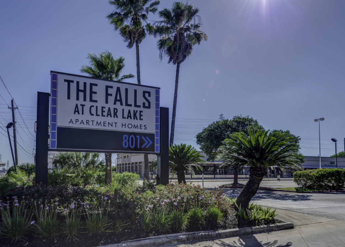 Property Sign at Falls at Clear Lake Apartments in Webster, TX