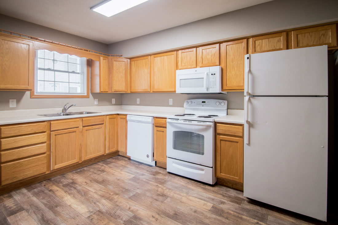 White Appliances and Wood-Look Flooring at Fieldstone Apartments in Lincoln, NE