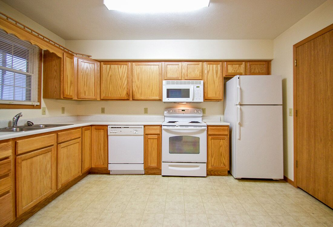 White Kitchen Appliances at Fieldstone Place Apartments in Lincoln, NE