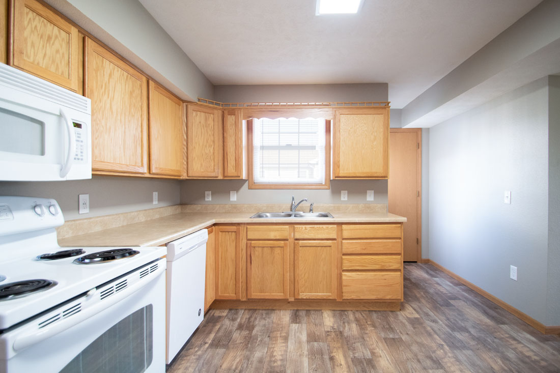Spacious Kitchen with Wood-Look Flooring at Fieldstone Apartments in Lincoln, NE