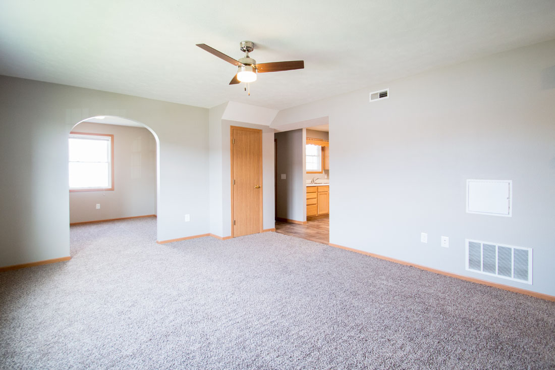 Carpeted Living Area with Ceiling Fan