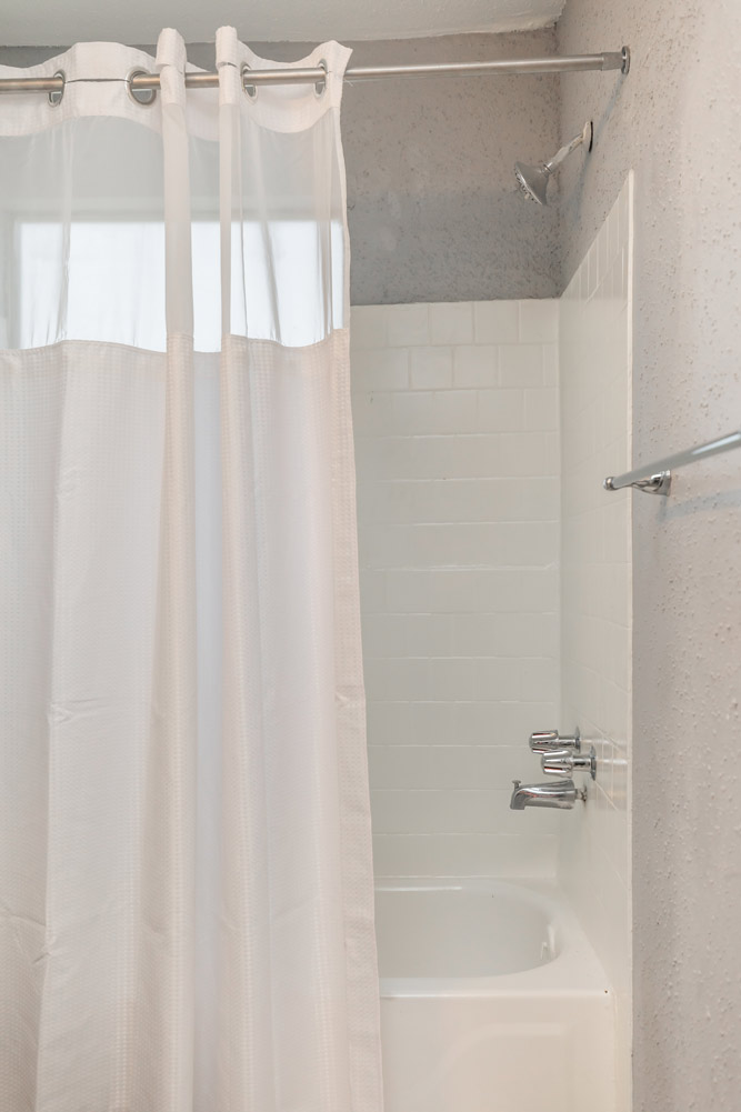 Shower and Tub Combination at The Five Points at Texas Apartments in Texas City, Texas