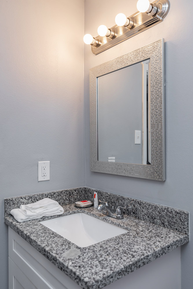 Bathroom with Mirror at The Five Points at Texas Apartments in Texas City, Texas